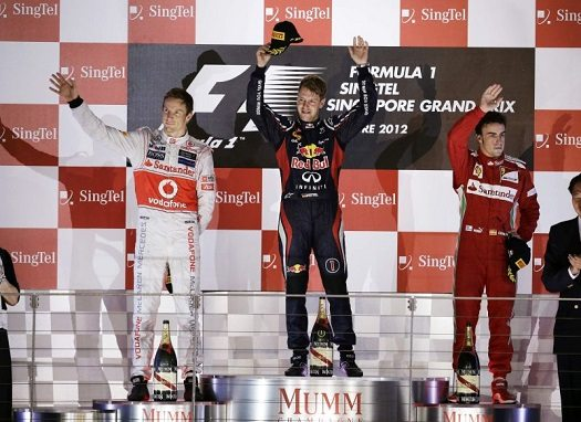 Red Bull Formula One driver Vettel of Germany, McLaren Formula One driver Button of Britain and Ferrari Formula One driver Alonso of Spain celebrate after the Singapore F1 Grand Prix